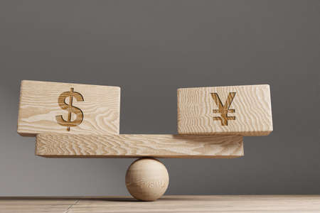 Dollar and Yen Supply and demand balance concept. Wooden cube block with words Dollar and Yen on seesaw. Life style concept