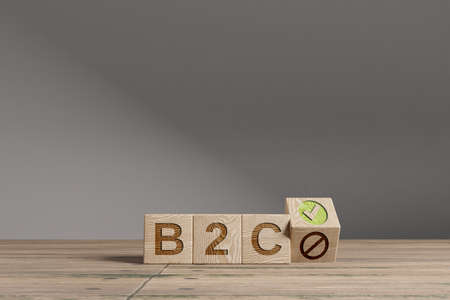 Wood cubes with acronym 'B2C' - 'Business To Customer' on a beautiful wooden table, studio background. Business concept with copy space.