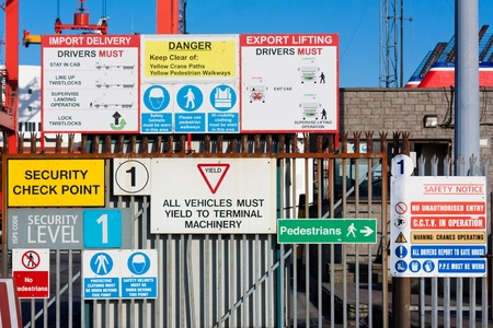Lots of warning signs in a sea port Stock Photo - 13153720