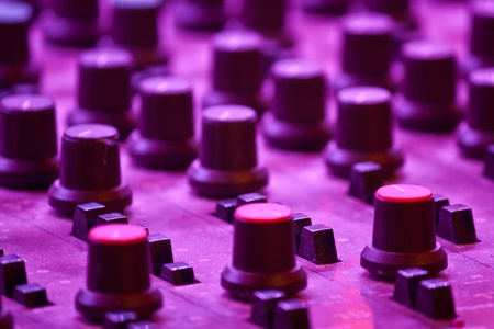 Mixing Table and channels with Purple Lighting photo