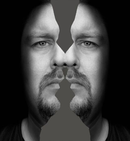 profil: Portrait of a man with a sad look and split head in Rorschach style Stock Photo