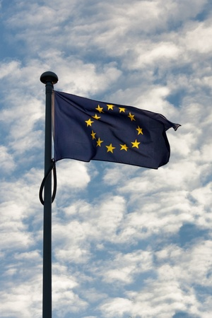 European and American flag waving next to each other photo