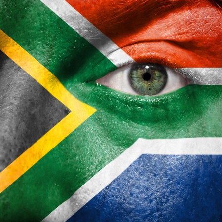 Flag painted on face with green eye to show South Africa support in sport matches Stock Photo - 13483508