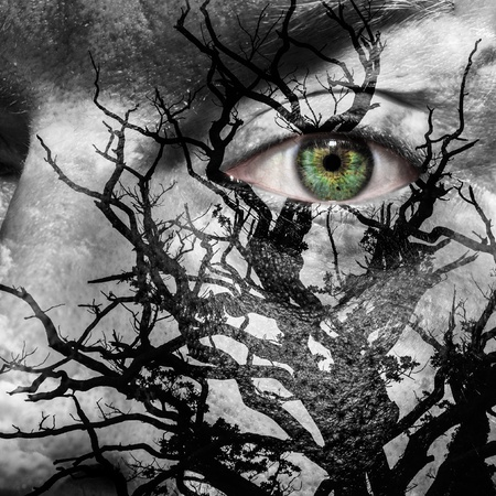 evil eyes: Face with green eye painted with medusa like tree Stock Photo