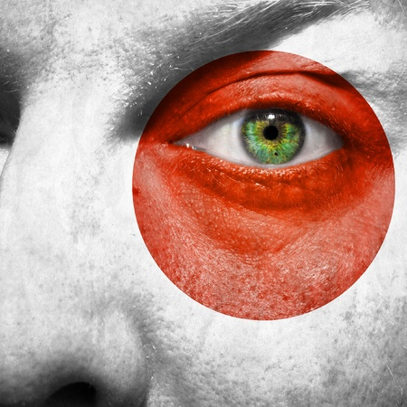 face paint: Flag painted on face with green eye to show japan support