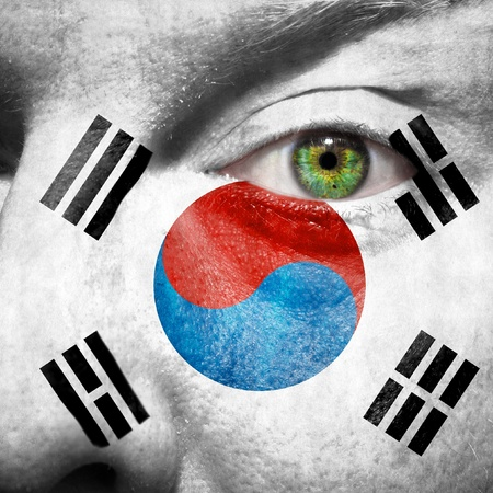follower: Flag painted on face with green eye to show south korea support