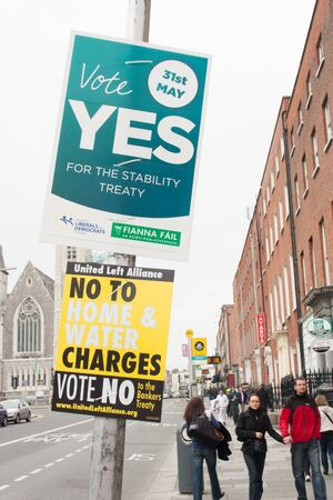 endorsing: DUBLIN - MAY 20: MAY 25:  Roadside election campaign placards endorsing the YES and NO vote on May 20, 2012 in Dublin. On 31 May 2012, the Irish people will vote in a referendum on whether to ratify the Stability Treaty.