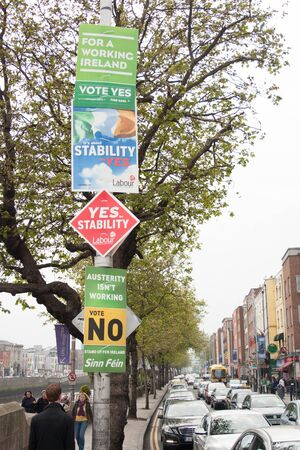 whether: DUBLIN - MAY 20: MAY 25:  Roadside election campaign placards endorsing the YES and NO vote on May 20, 2012 in Dublin. On 31 May 2012, the Irish people will vote in a referendum on whether to ratify the Stability Treaty.