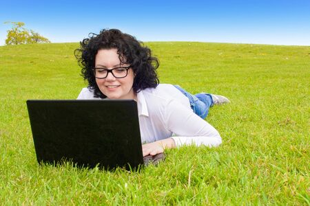 lunchbreak: Business Woman with notebook in a meadow