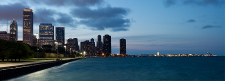Chicago skyline and navy pier at dusk photo