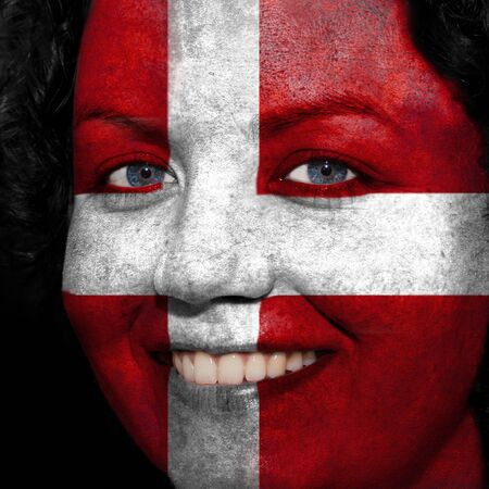 follower: Woman with flag painted on her face to show Austria support in sports