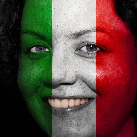 follower: Woman with flag painted on her face to show Italy support in sports