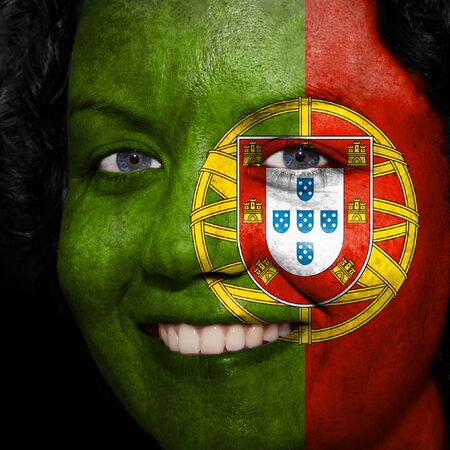 Woman with flag painted on her face to show Portugal support in sports photo