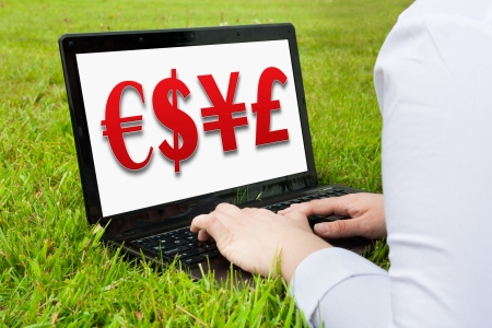 Woman working outdoors on laptop showing currency 3D photo