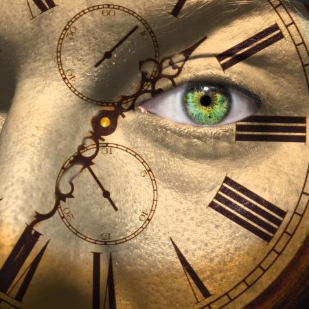 高齢化や生物時計の概念を男性の顔に描かれた時計 写真素材