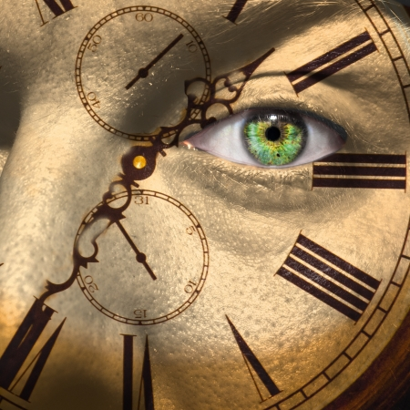 Clock painted on male face to aging or bio clock concept photo