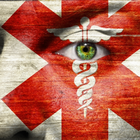 Caduceus painted on a  mans face to show support to medical heroes and first aiders Stock Photo