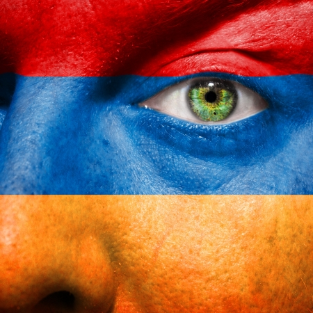 follower: Flag painted on face with green eye to show Armenia support