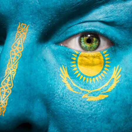 mongols: Flag painted on face with green eye to show Kazakhstan support