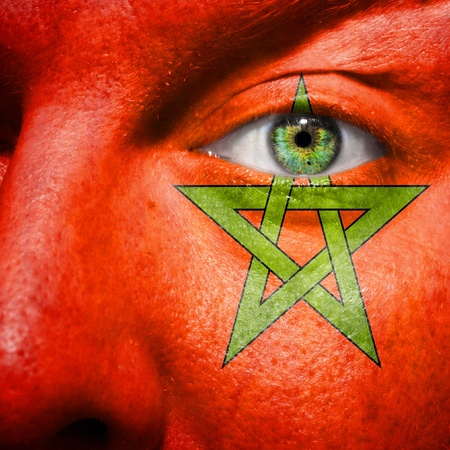 pentagram: Flag painted on face with green eye to show morocco support Stock Photo