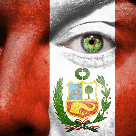 Flag painted on face with green eye to show Peru support photo