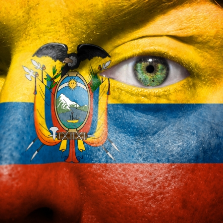 ecuador: Flag painted on face with green eye to show Ecuador support