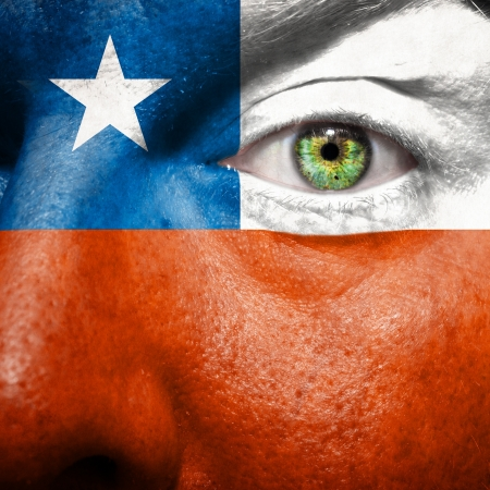 Flag painted on face with green eye to show Chile support photo
