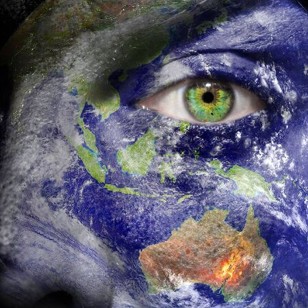 Oceania painted on face with green eye to promote a better world photo