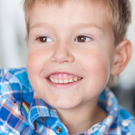 dowdy: Close up of handsome little boy with a big smile on his face and a twinkle in his eyes