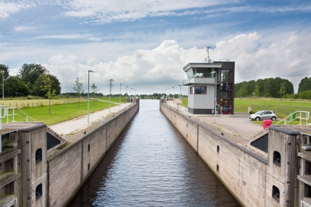 lift lock: Typical Dutch lock and control room as seen in waterways and canals in the Netherlands