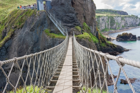 Famous Rope Bridge at Carrick-a-Rede in Northern Island taken from the connecting islands photo