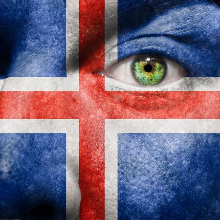 face paint: Flag painted on face with green eye to show Iceland support