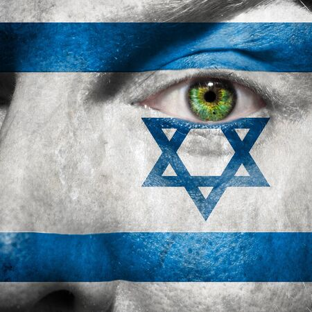 Flag painted on face with green eye to show Israel support Stock Photo - 14981119