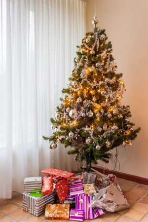 Christmas tree and presents as found in Dutch homes at Christmas and new year