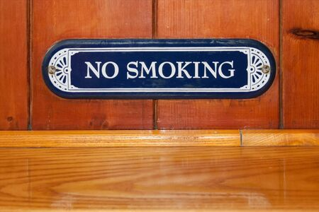 Old fashioned no smoking sign on wood in a restaurant Stock Photo - 15505778