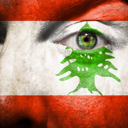 steadiness: Flag painted on face with green eye to show Lebanon support