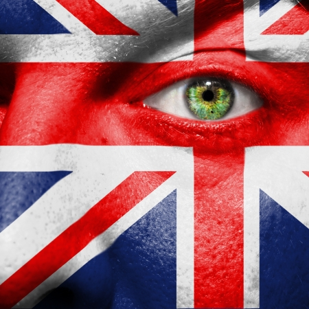 Flag painted on face with green eye to show UK support photo