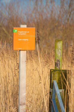 ijssel: Warning post Entrance to a bird nesting reserve in the floodplains of the Ijssel river in The Netherlands Stock Photo