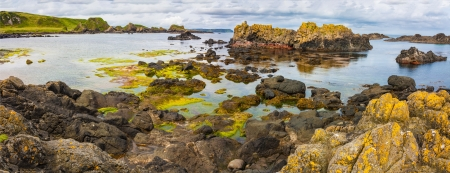 Ballintoy bay in Nothern Ireland small basalt isles and rock formations of various kinds rise out of the atlantic ocean photo