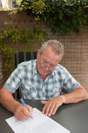 Senior signing a legal contract photo