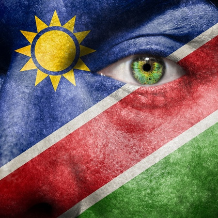 Flag painted on face with green eye to show Namibia support photo