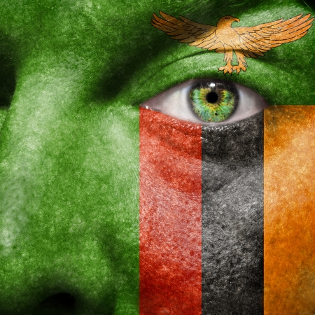 zambia: Flag painted on face with green eye to show Zambia support