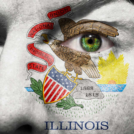 Flag painted on face with green eye to show Illinois support photo