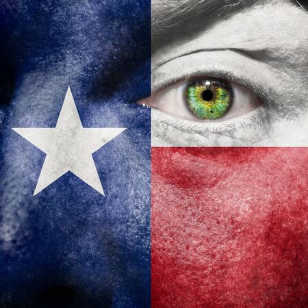Flag painted on face with green eye to show Texas support photo