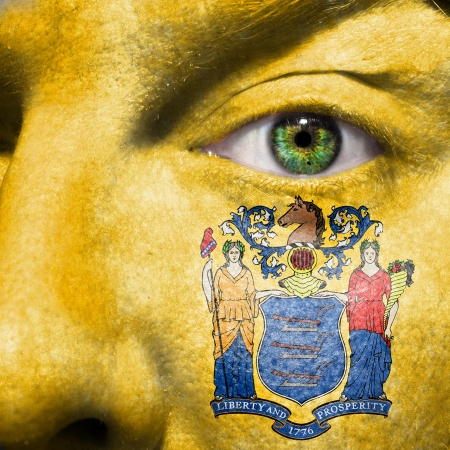 goddesses: Flag painted on face with green eye to show New Jersey support