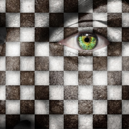 Checkers board or finish flag on male face with green eye photo