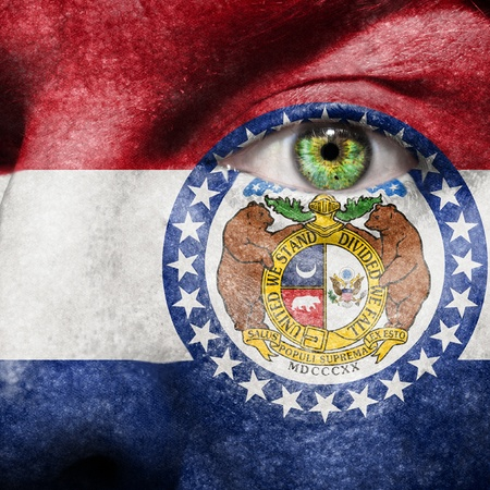 Flag painted on face with green eye to show Missouri support Stock Photo - 19352057