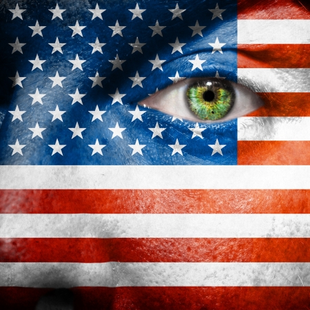 face paint: Flag painted on face with green eye to show USA support