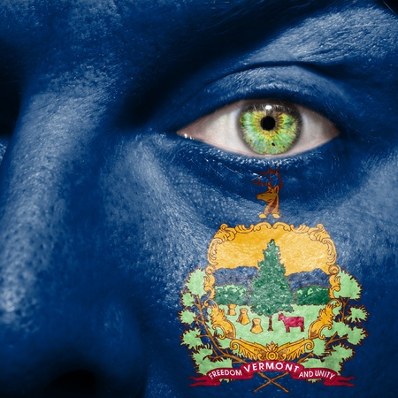 Flag painted on face with green eye to show Vermont support photo