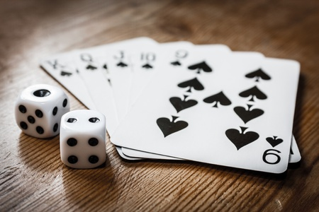 Hand of cards and two dice Stock Photo - 19352203